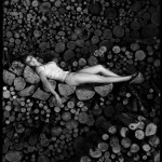 Model on wood pile photo by Frank Petronio
